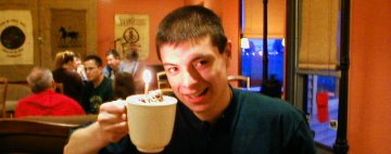 Nathan Matias Goes Drinking -- Hot Chocolate with a 21st birthday candle in the whipped cream